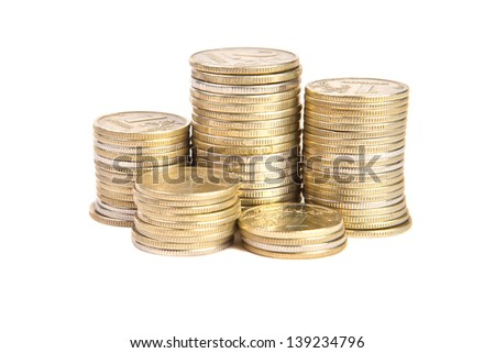 Stacks of coins on a white background - stock photo