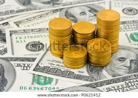 Stacks of coins on money - abstract business background - stock photo