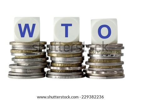 Stacks of coins with the letters WTO isolated on white background  - stock photo