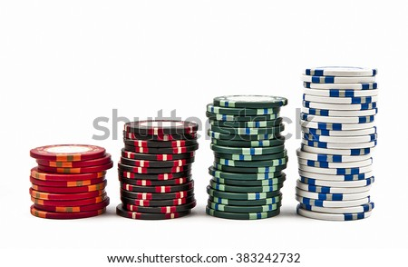 Stacks of colored poker chips isolated on white background - stock photo