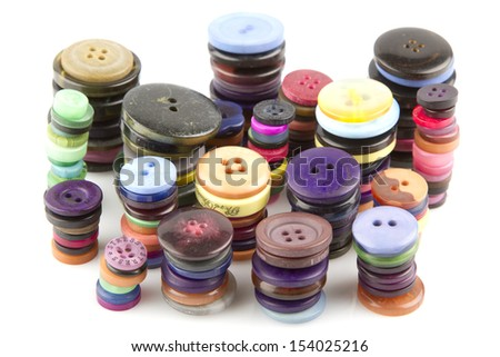 Stacks of colorful buttons on a white background - stock photo
