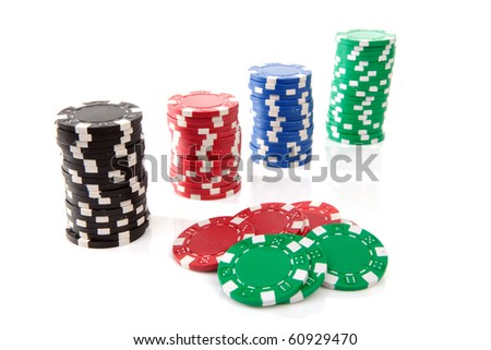 stacks of colorful poker casino chips over white background