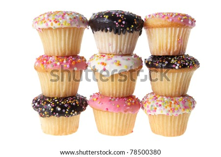 Stacks of Cup Cakes on White Background - stock photo