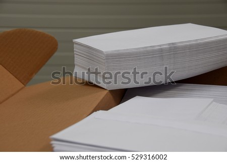 Stacks of envelopes on a desk