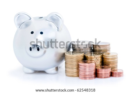 Stacks of Europeans coins with piggy bank, isolated on white background