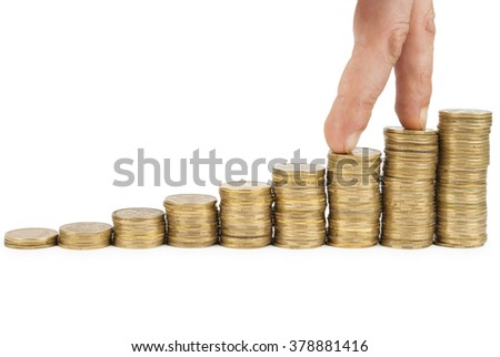 Stacks of gold coins and human hand - stock photo