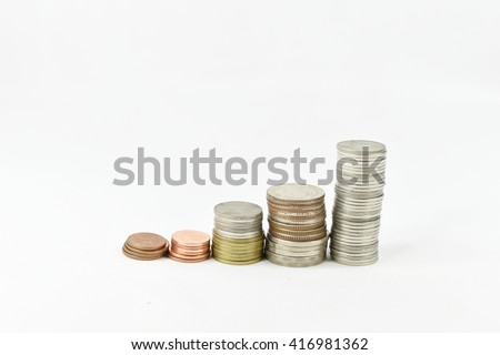 Stacks of gold,silver,copper coins. Income and profits. Isolated on white background.