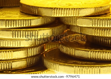 Stacks of golden coins, in close-up.