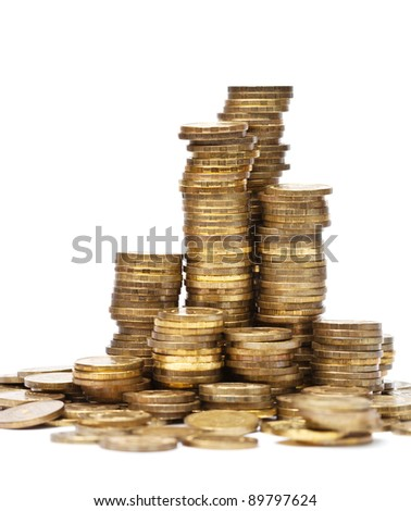 Stacks of golden coins with shallow dof - stock photo