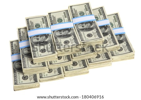 Stacks of hundred-dollar bills on white background - stock photo