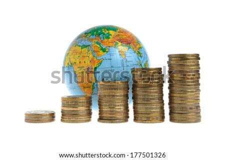 Stacks of money with globe isolated on white background - stock photo