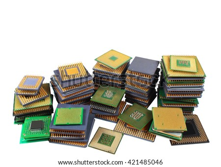 Stacks of old CPU chips and obsolete computer processors isolated on white background - stock photo