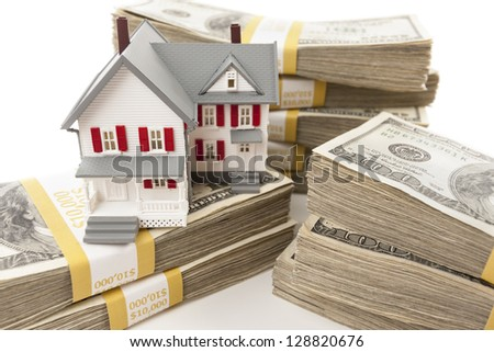 Stacks of One Hundred Dollar Bills with Small House. - stock photo
