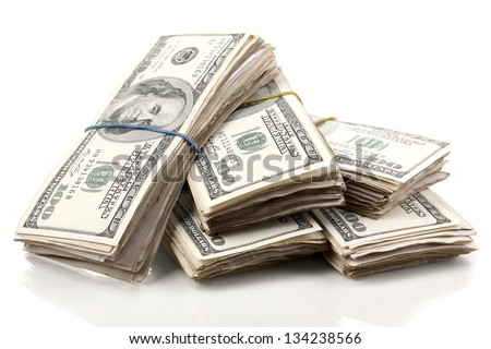 Stacks of one hundred dollars banknotes close-up isolated on white