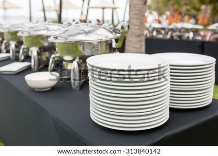 Stacks of plates for a buffet/ Stacks of plate - stock photo