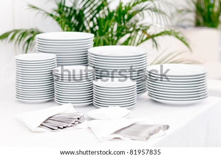 Stacks of plates for a buffet/ Stacks of plates - stock photo