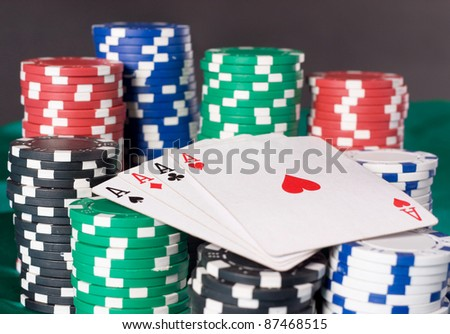 Stacks of poker chips including red, black, white, green and blue