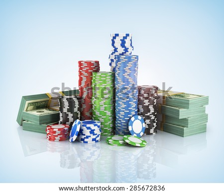 Stacks of poker chips with stack of dollars. - stock photo