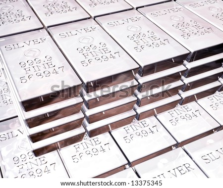 stacks of pure silver bars on piles of bullion - stock photo
