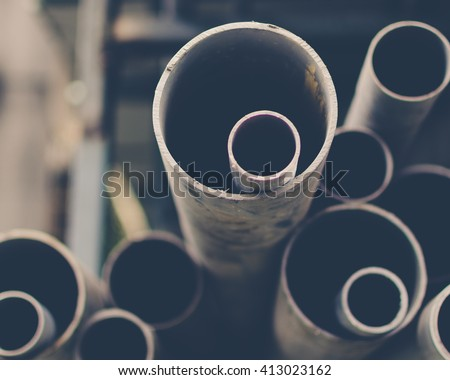 Stacks of PVC water pipes. Abstract circular water pipe. Selective focus. Black and white image. - stock photo