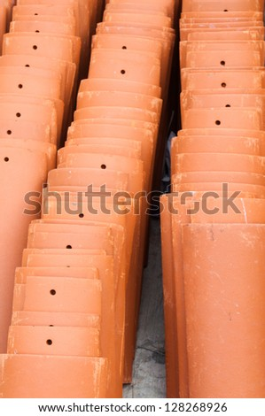 Stacks of roof tiles ready for installation - stock photo