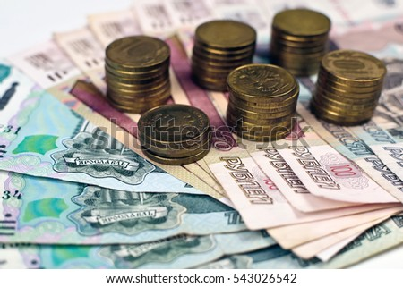 stacks of russian coins on banknotes background