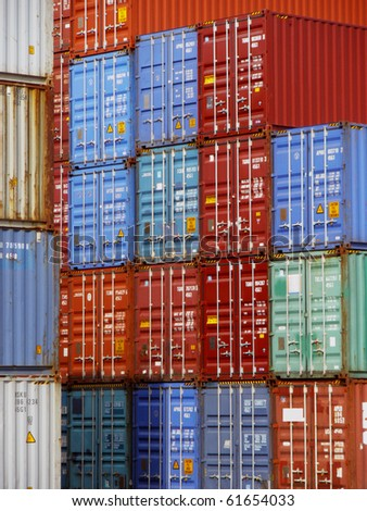 Stacks of shipping containers at a port - stock photo