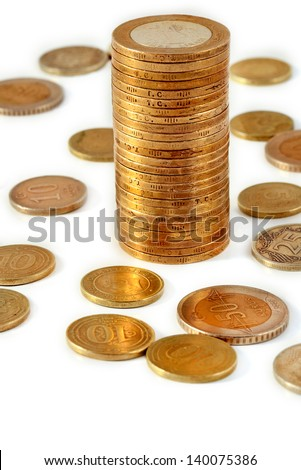 stacks of Turkish coins on white background  - stock photo