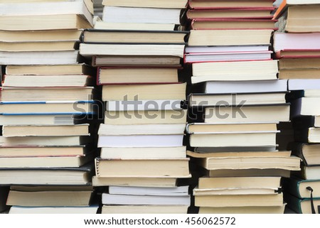 Stacks of used books at flea market - stock photo