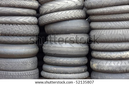 Stacks of used car tires - stock photo