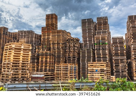 Stacks of used Wooden Euro Pallets at a Recycling Depot - stock photo