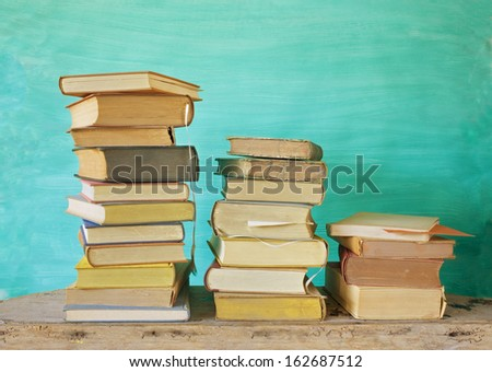 stacks of vintage books, free copy space - stock photo