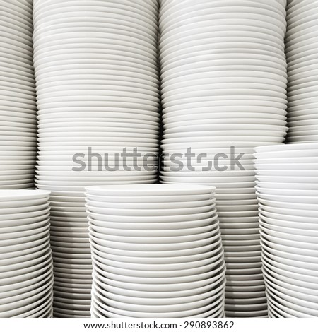 Stacks of white ceramic plates in a store. - stock photo