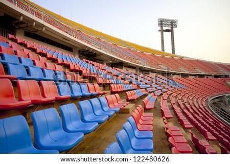 stadium curve, red and blue seat on stadium steps bleacher - stock photo