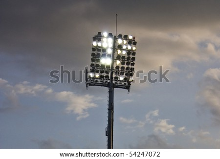Stadium lights and blue sky - stock photo
