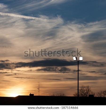 stadium lights in sunset sky  - stock photo