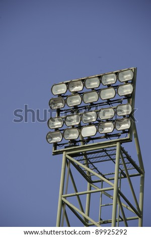 Stadium lights on a sports field - stock photo