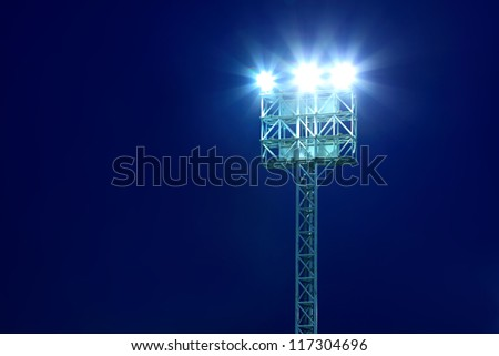Stadium Lights With Blue Sky Background - stock photo
