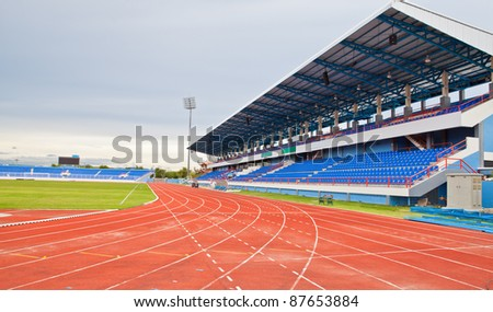 Stadium main stand and running track - stock photo