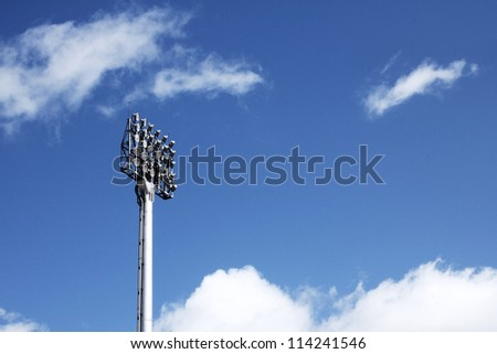 Stadium spotlight with blue sky - stock photo