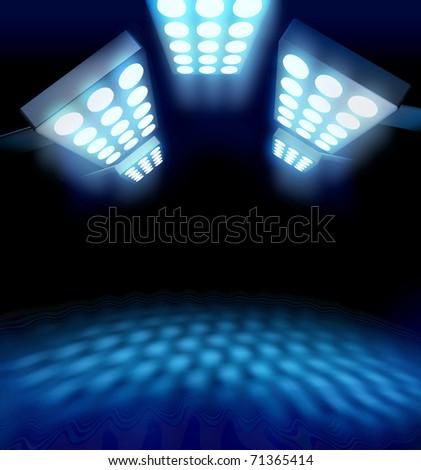Stadium style premiere lights illuminating blue surface on dark background - stock photo