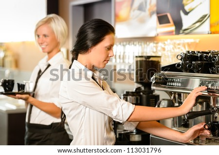 Staff at cafe making coffee espresso machine woman working bar - stock photo