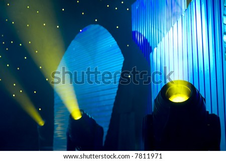 Stage blue and yellow lights - prepared for production and shooting - Light and smoke - stock photo