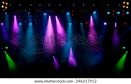Stage lights and Laser rays with smoky effect background - stock photo