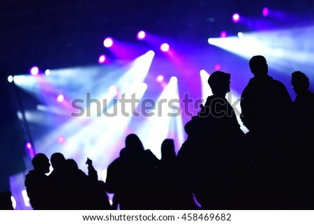 Stage lights. Concert scene with crowd in the foreground
