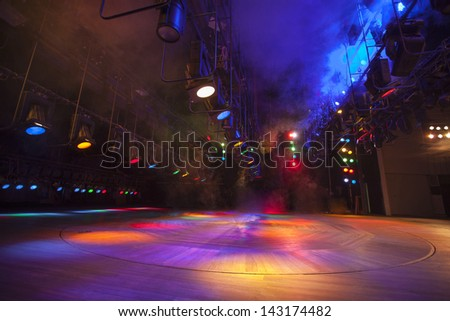Stage lights on a console, smoke - stock photo