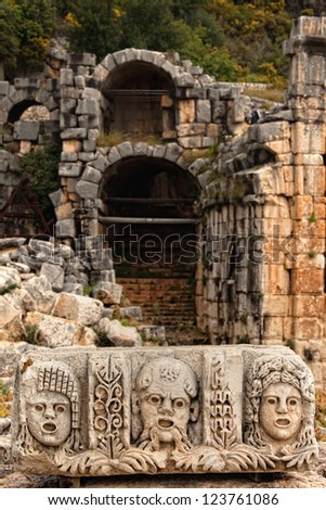 Stage masks in front of ruins at Myra Turkey - stock photo