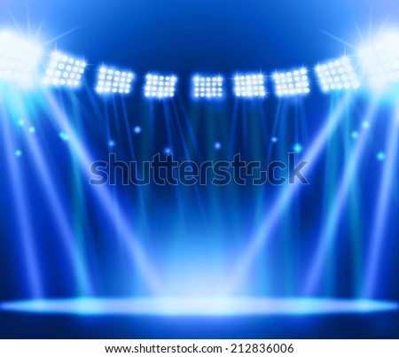 stage spot lighting over blue background. - stock photo