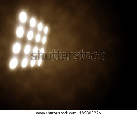 stage spotlights in artificial smoke - stock photo