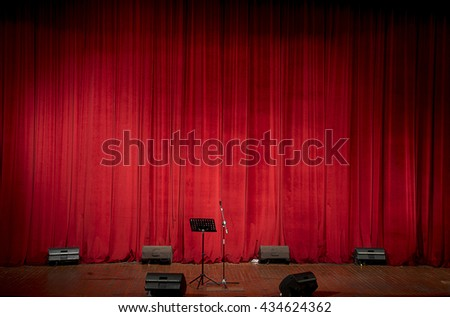 Stage theaher with red curtain as a space for your text    - stock photo